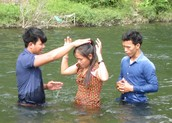 Pastor Uy's wife being baptized.