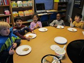 Kindergarten friends enjoying the pie.