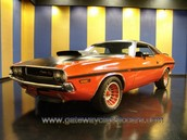 1971 dodge challenger rt with a 440 six pack motor in it.