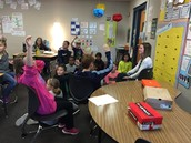 Students spend time getting to know Ms. Gartner.