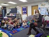 Laura Cherrito from MCPL reading to Mrs. Lohman's class.