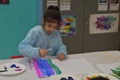 Zahra painting with cotton balls