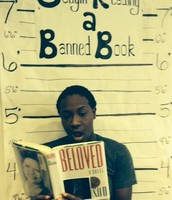 Coach Jacobs with the frequently banned book Beloved during Banned Book Week at KHS