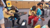 4th and 5th graders are learning to play the guitar.