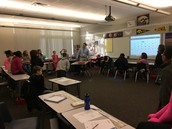 5B Morning Meeting- Mr. Berg is reviewing the daily and weekly plan with his students