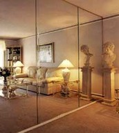 Mirrors are frequently used as a wall treatment to...