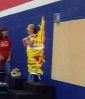 Mrs. Lacroix duct taped to the wall!