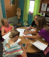 Students recording information in STEM learning logs.