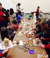 Mrs. Harley's class building gingerbread houses