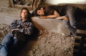 ponyboy and johhny laying in the church