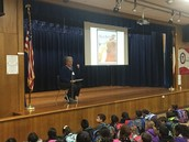 The amazing Ms. Swingle reads a true story about pets at W.A.R.P. Wed. Assembly!