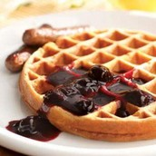 Waffles toped with blueberry jam