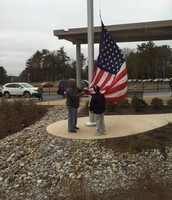Mr. Joe raises the American Flag with a different student each day!