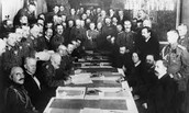 1918- (March 3) Lenin agrees to the Treaty of Brest-Litovsk with Germany