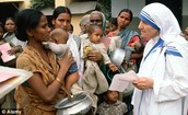 Mother Teresa at her with mothers and children at her Mission in Kolkata.