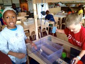 """Using string we created a pulley system to dunk the sponges and """"move water vapor."""""""