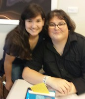 Anastasia Cruz, SNJH student, poses with e.E. Charlton Trujillo