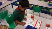 Krishav is identifying if his apple has a stem or not!