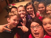 Ms. Donovan takes a museum selfie with students from Mrs Judd's 3rd grade class.