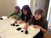 Using ink wells to write.