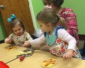 Britt and Addie learn to make pancakes with Renee.