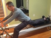 Paul LaBarbera takes a lunge on the reformer.