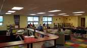 8th graders using library time to get in a little reading