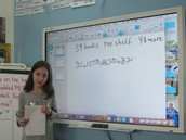 A Student Demonstrates Her Thinking on the Smartboard