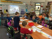 Students record on their 120 charts during Mystery Skype