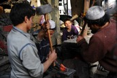 Afghan Children Work At A Blacksmith In Kabul