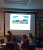 Students presenting using Keynote
