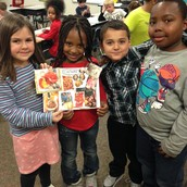 Kids worked together in teams to create posters that show what culture means.