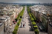 The busy street of Les Champs-Elysées today.