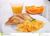 Scrambled eggs, toast, orange juice