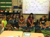 Caleb sits and meets with Mrs. Rick's 3rd graders