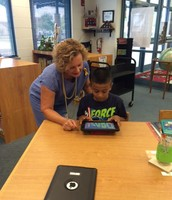 Mrs. Trolinger (Travis Elementary) with a Student