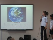 Students presenting their Power points during Assembly.