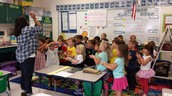 "Mrs. Trout teaching us the song ""Oh Do you know the Apple Man?"""