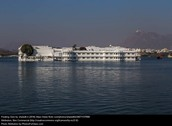 Floating Lake Palace with mountain in back