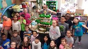 Mr. Griffiths with Mrs. Valentino's students and their Cupcake Tree House