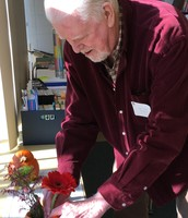 Katie's grandfather creating a beautiful centerpiece
