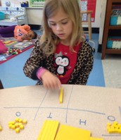 Bella working in a place value chart.