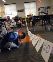 Mrs. Persson's class counting to 100 while synergizing to make it happen!
