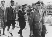 Heinrich himmler walks with other nazis.