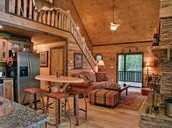 A log cabin living room/ kitchen