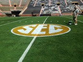 sec logo being painted