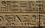 Hieroglyphics were written on walls to show respect for the pharaoh's gods and godesses