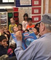 Mr. Hosp reading to a kindergarten class.