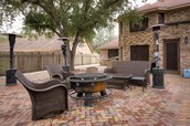 Huge back patio covered with pavers-great for entertaining