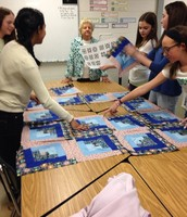 Creating different quilt designs by re-arranging the squares.